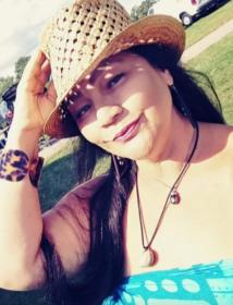 Schantell Puameole Taylor wearing a hat