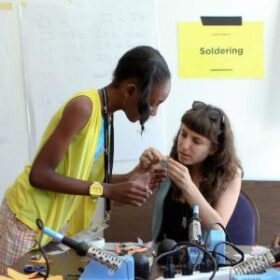 two people working on a tech project at a community discotech