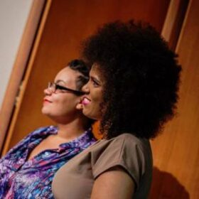 Two Black women on stage, presenting as Octavia's Brood
