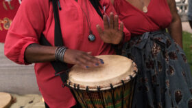 Person playing a hand drum