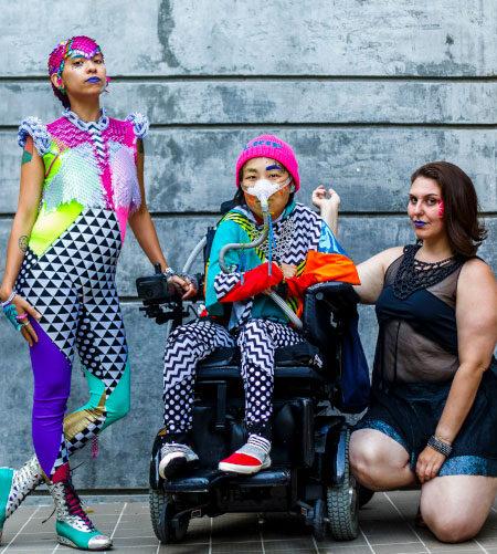 Three people posing in Rebirth Garments clothing
