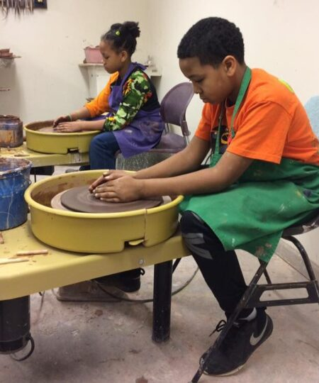 Ladybug Studios drop-in session with two kids on throwing wheels