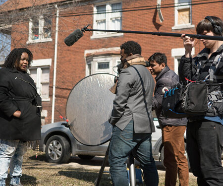Production shot from Take Me Home with the crew filming an actor