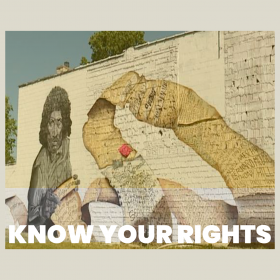 """Street art on a wall with a scroll of the names of people killed by police with the title """"Know Your Rights"""""""